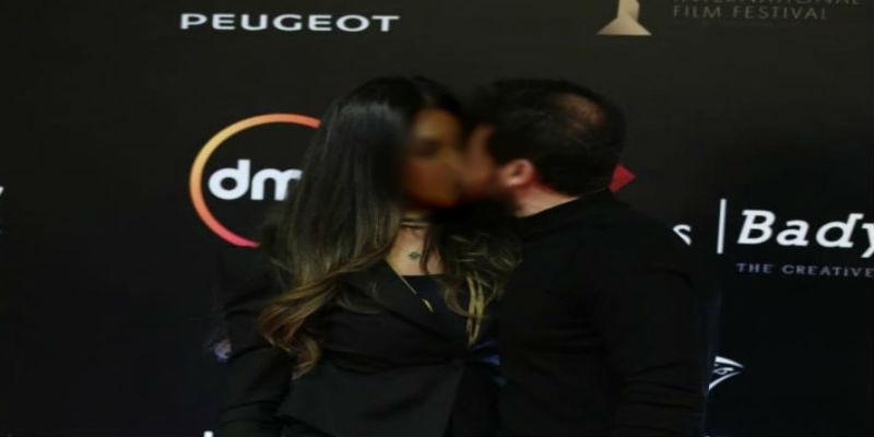 صورة في أول ظهور لهما.. الجندي يقبل زوجته على السجادة الحمراء